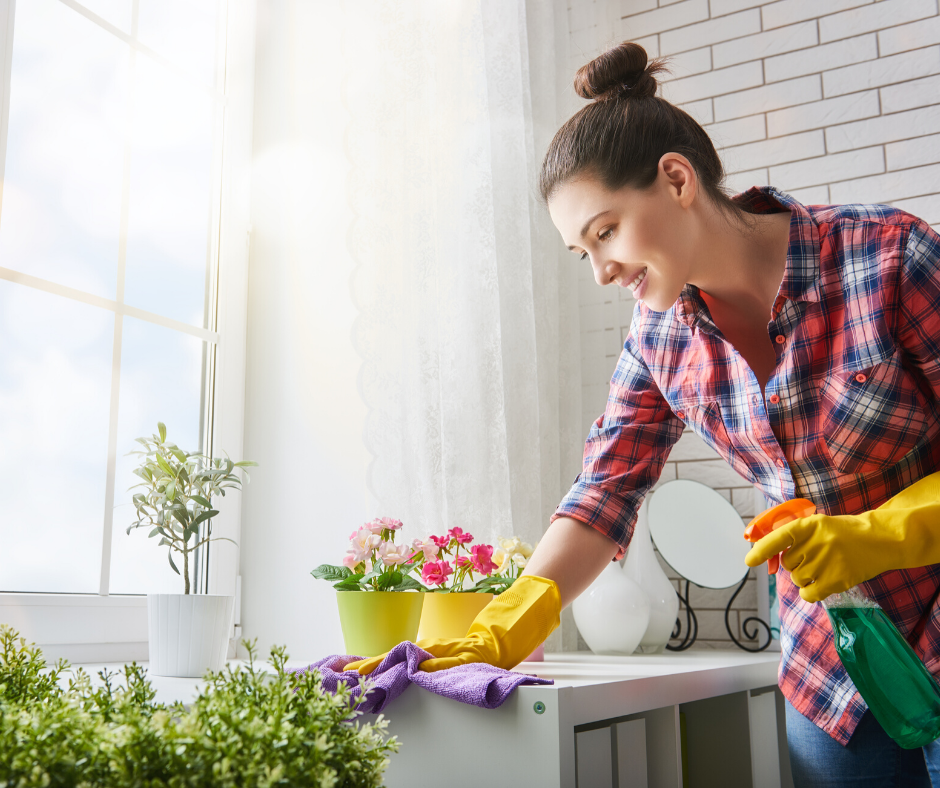 fun things to do at home: Woman cleaning kitchen